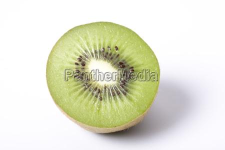 halved kiwi on white background