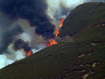 wild fire on mountain ridge