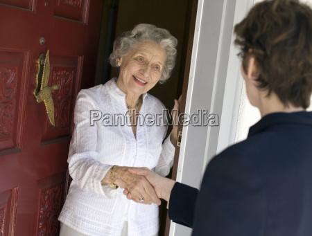 senior woman friendly handshake