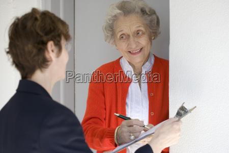 smiling, senior, woman, signing, petetion - 1409473