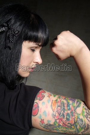 woman with tattooed arm