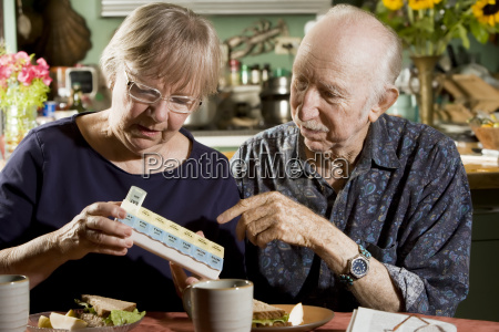 portrait of senior couple with pill