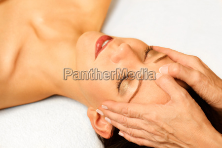 young woman gets facial massage