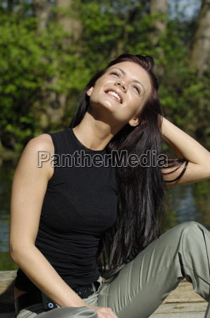 a young woman is sitting on
