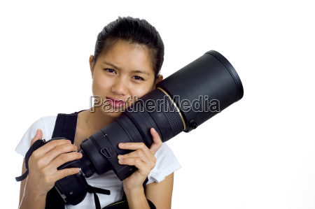young asian with camera and tele