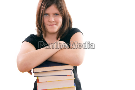 schoolgirl supports arms on book piles