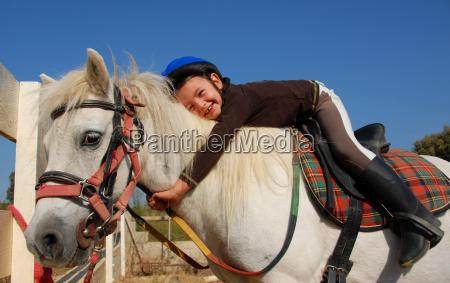 little girl and shetland pony