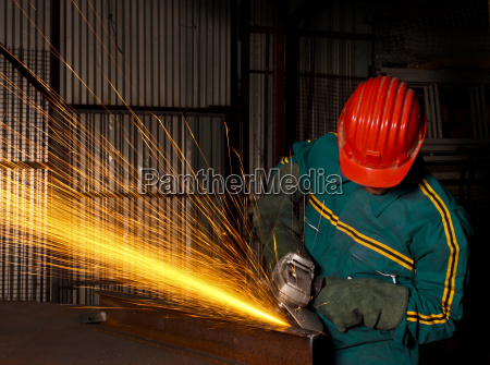 heavy industry manual worker with grinder