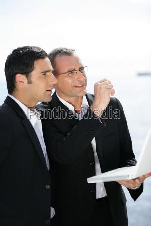 businessmen, working, outdoor, with, laptop - 1604773