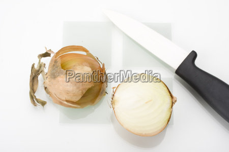 halved onion and a knife on