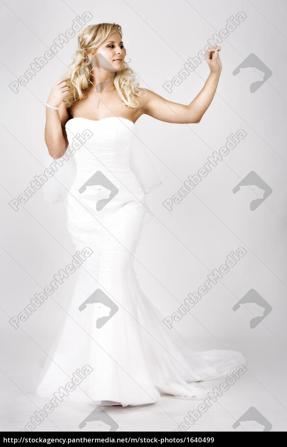 young, bride, in, wedding, dress, walking - 1640499