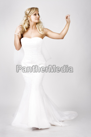 young, bride, in, wedding, dress, walking - 1640499