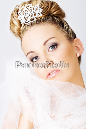 young, bride, holding, a, veil - 1642527
