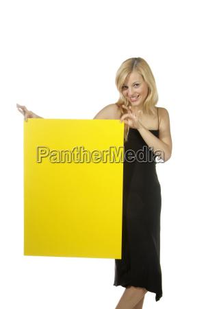 blond woman ironing board yellow