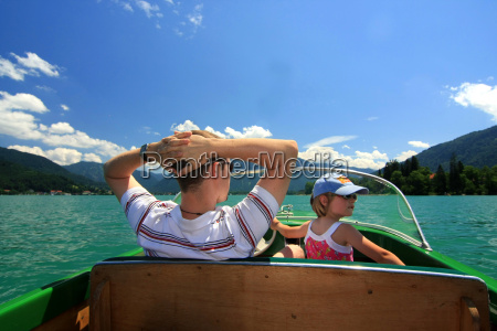 father and daughter boating