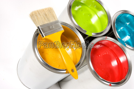 opened paint buckets with paintbrush