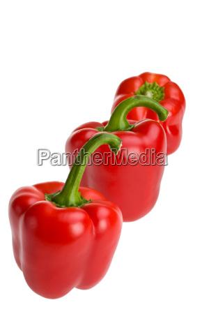 three red pepper s in a