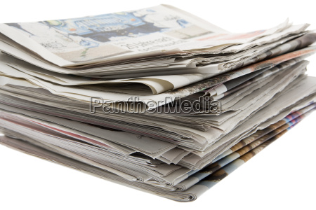 press pile of newspapers