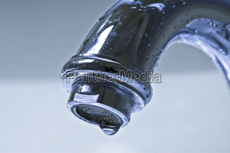 dripping chrome bathroom faucet