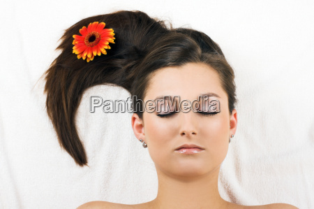 relaxed woman having spa with flower