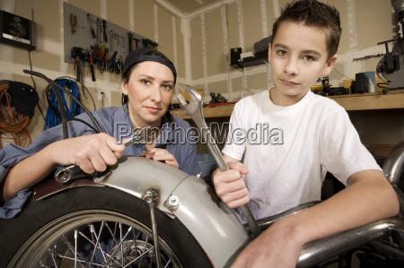 hispanic woman and boy in garage