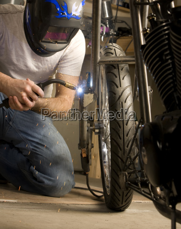 welder, working, on, motorcycle - 1746189