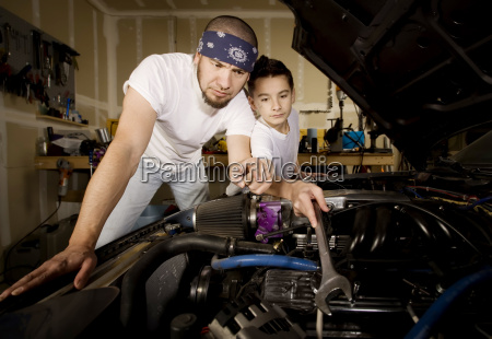 hispanic father and son in garage