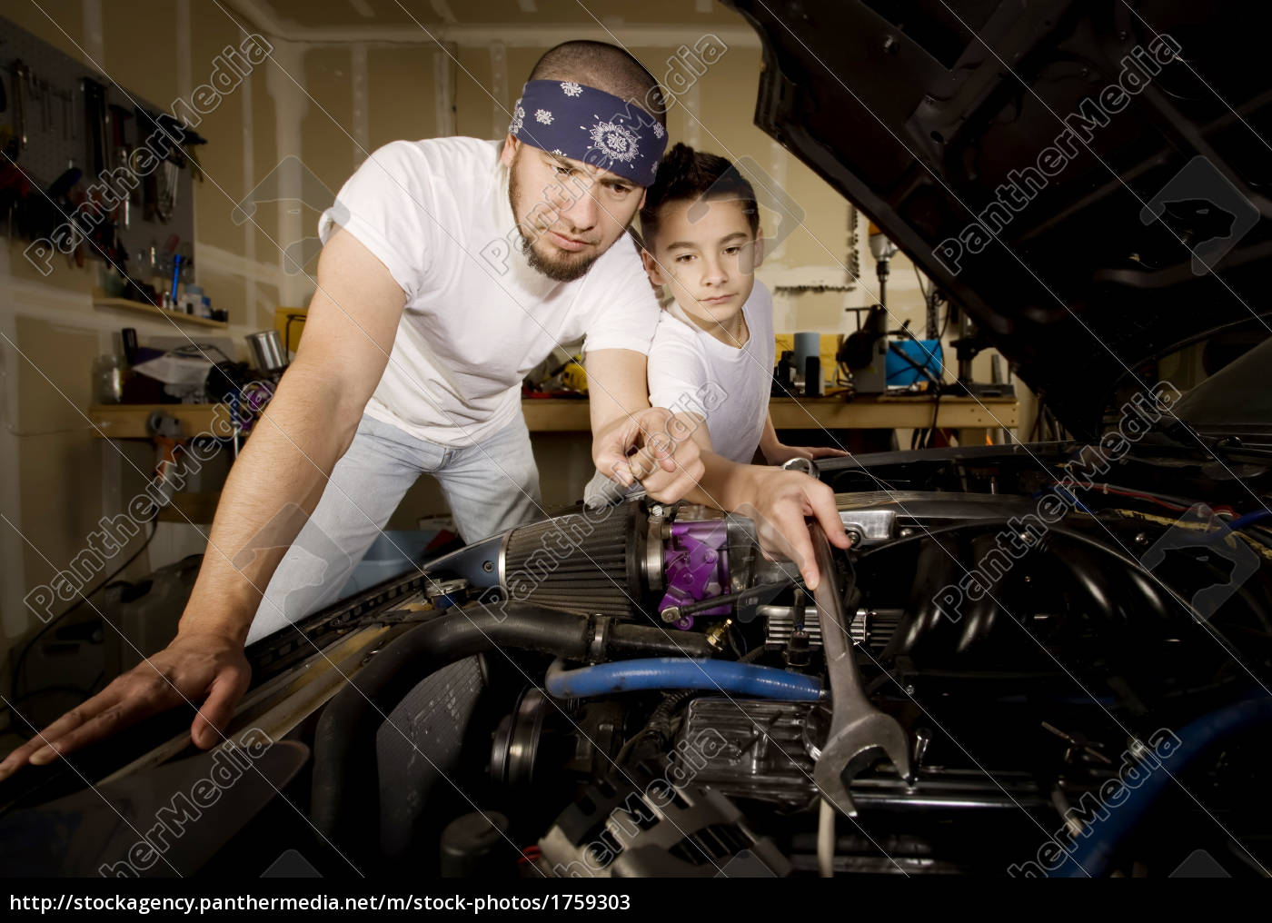 hispanic, father, and, son, in, garage - 1759303