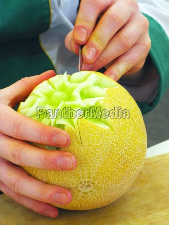 cantalupe melon and hands carving