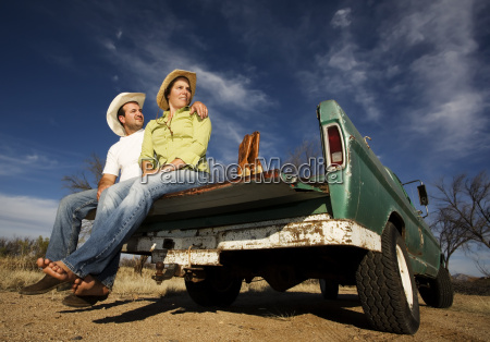 cowboy, and, woman, on, pickup, truck - 1792975
