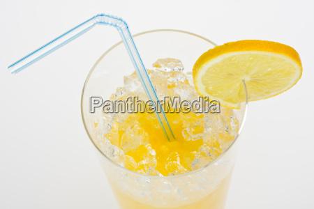 glass of orange juice with lemon