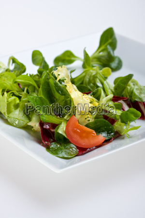 mixed salad on a white plate