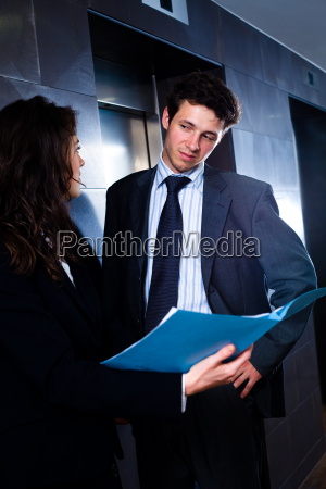 businesspeople looking at folder