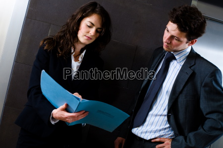 businesspeople reading document