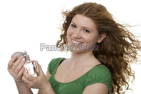red haired teenager with perfume