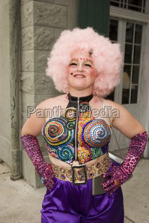 woman wearing rhinestone vest pink hair