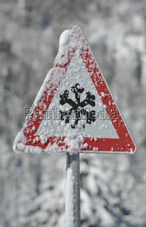 sign warning of packed snow