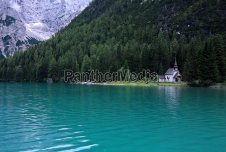 mountain lake with chapel