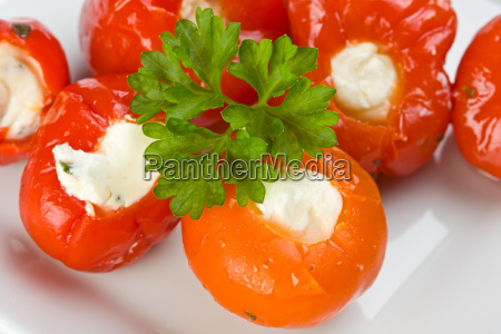 stuffed tomatoes on a white plate