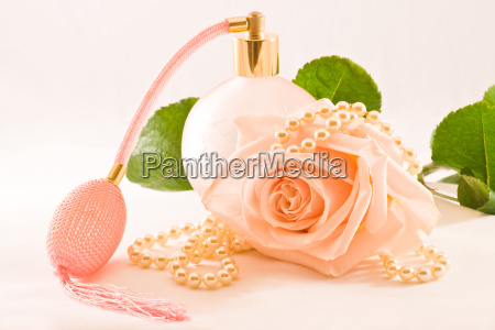 pink glass scent bottle with rose
