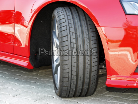 wide tires on red body
