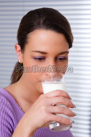 woman drinking a glass of healthy