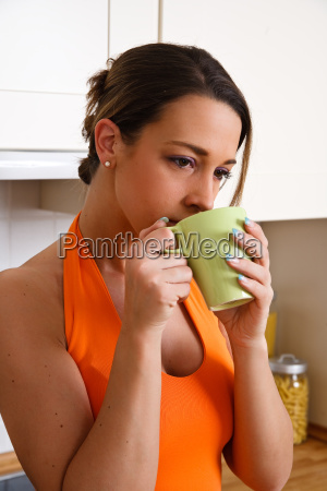 young woman drinking a cup of