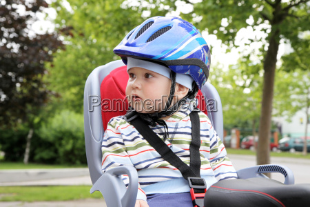 child sitting by bicycle in crash