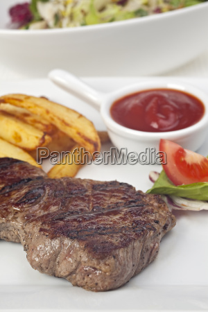 steak and french fries on a