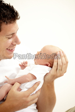 young papa with baby