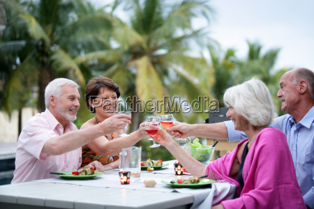 group of seniors friends toasting