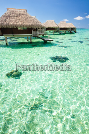 overwater bungalow with steps into lagoo
