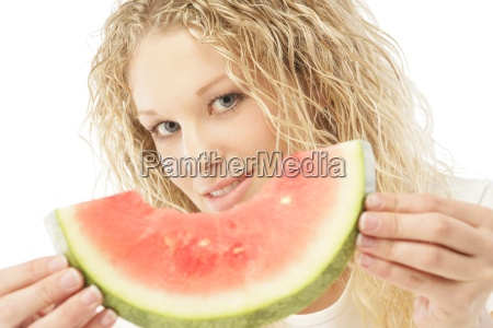woman holding slice of watermelon
