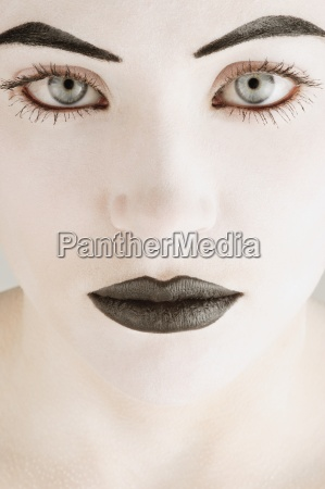 a womans face in black and
